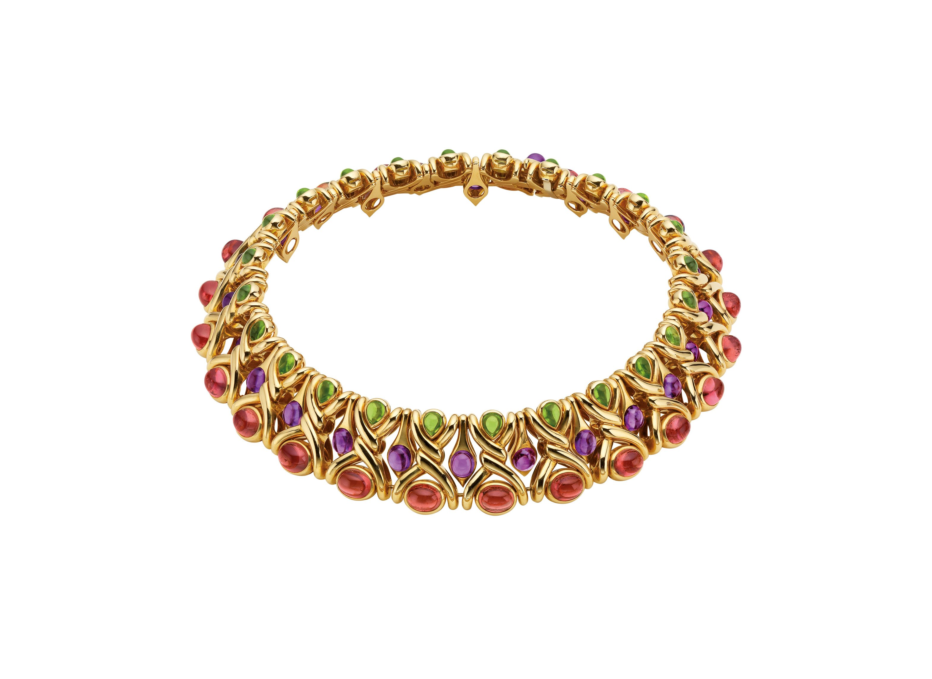 "Necklace in gold with pink tourmalines, amethysts and peridots, 1988. Designed as wide band of gold knotted motifs set at the centre with a row of circular cabochon amethysts, the borders decorated respectively with a line of oval cabochon tourmalines and of pear-shaped peridots. Marks: on the reverse of the mount (near the clasp) ""BVLGARI"" stamped; C 1988; lozenge with ""750""; polygon with ""star / 2337 / AL""; on the tonguepiece ""SC""."