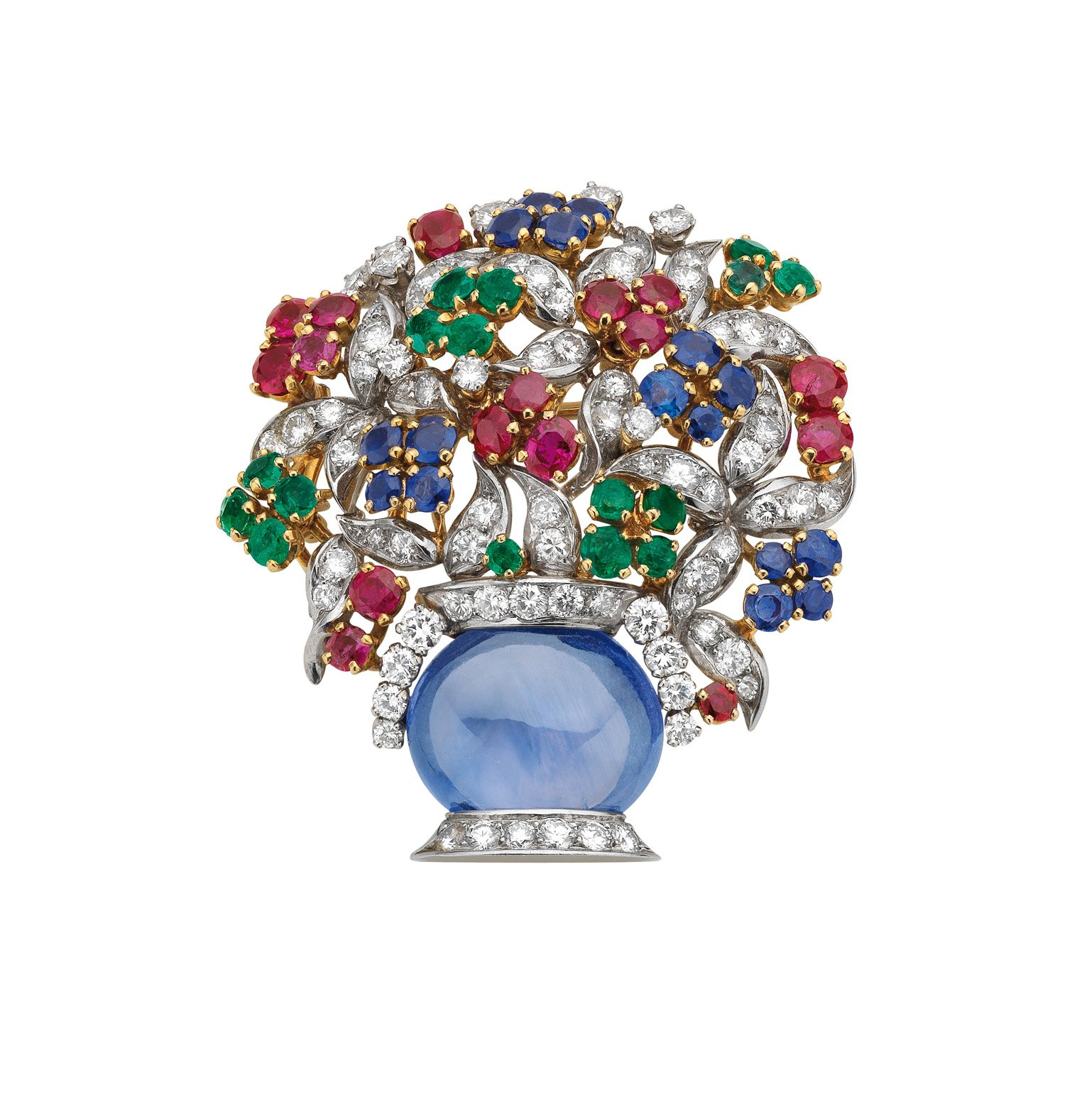 """Giardinetto"" brooch in gold and platinum with sapphires, emeralds, rubies and diamonds, 1960. The vase formed of an oval cabochon sapphire on a diamond-set stand, the foliage suggested by leaf-shaped diamond pave set motifs, the flower-heads decorated with circular-cut emeralds, rubies and sapphires. Marks: on the mount, at the base of the vase: ""BVLGARI"" engraved."